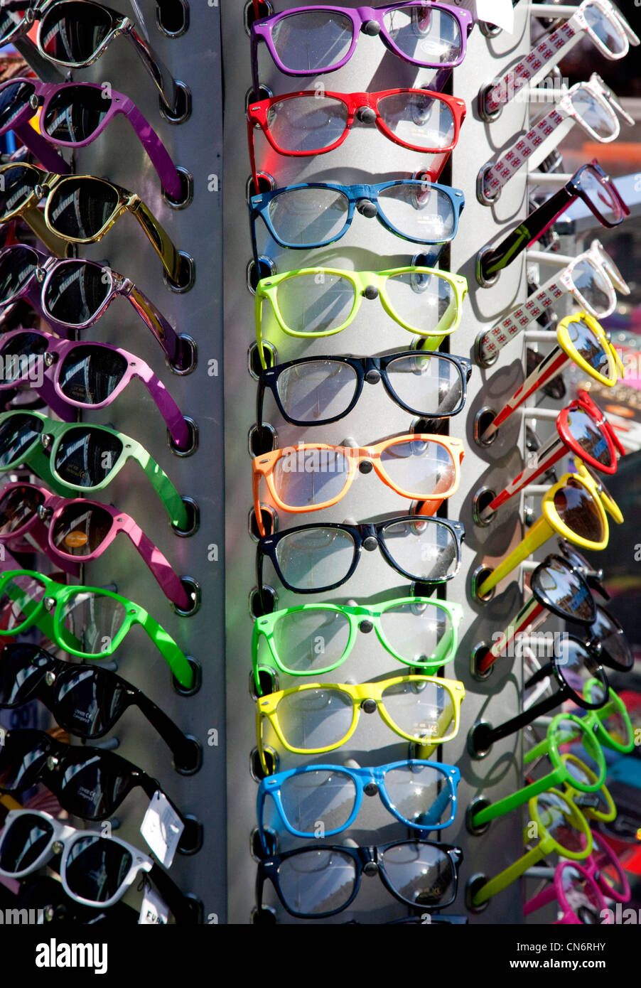 Inexpensive fashion sunglasses on sale in London shop - Stock Image