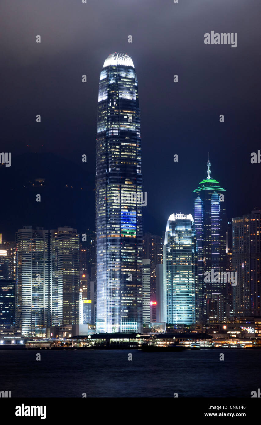 View from Kowloon at the evening laser light show on the skyscrapers on Hong Kong Island, Hong Kong - Stock Image