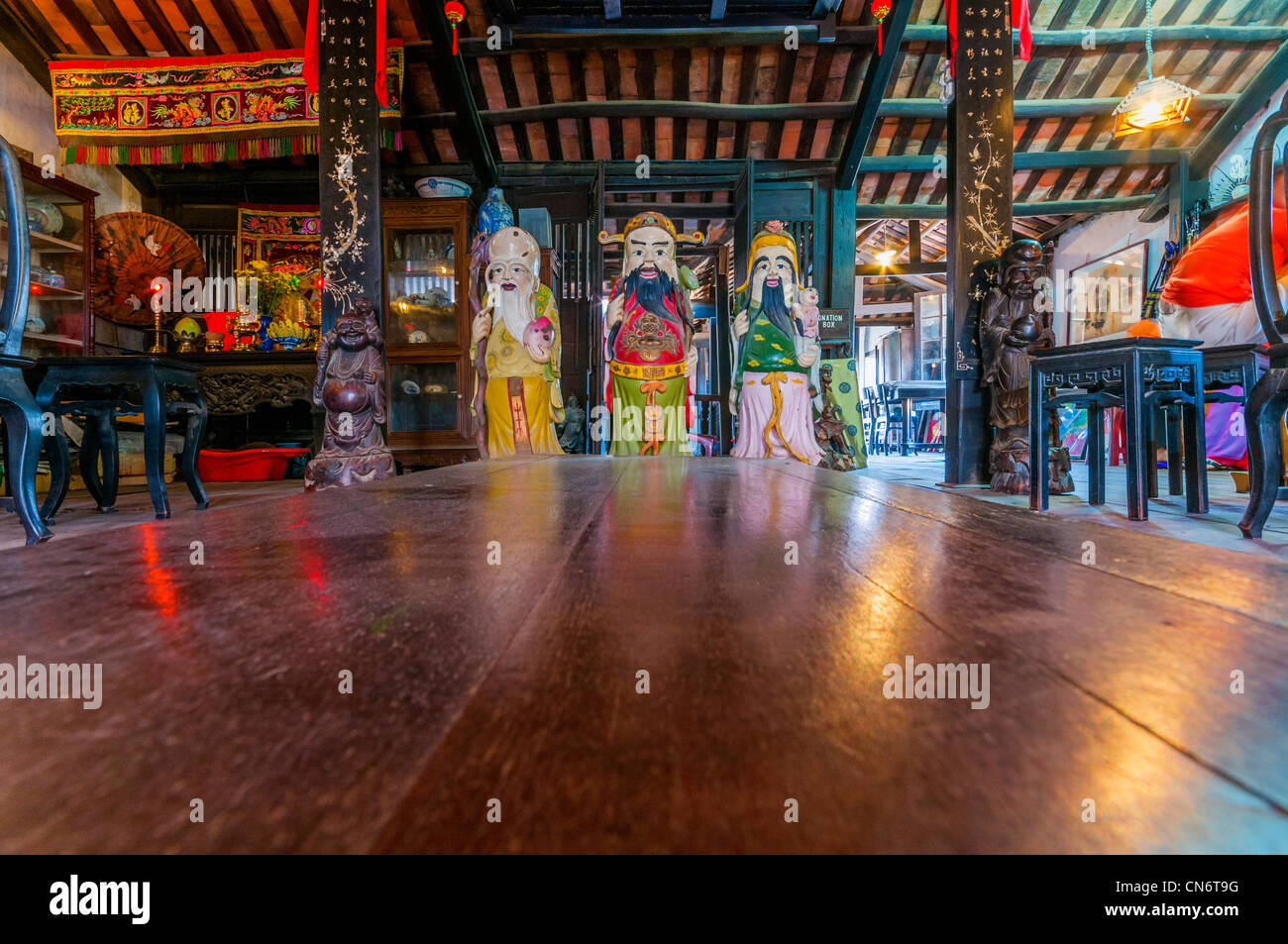Three statues representing Happiness, prosperity, long life. Old house of Phung Hung, Hoi An's Old Town. Vietnam, - Stock Image