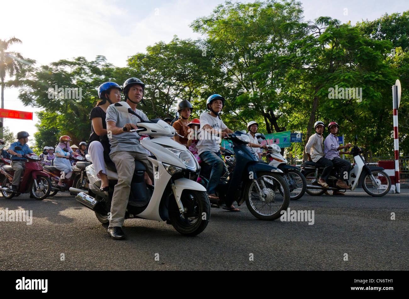 Motorbikes at Traffic Lights, Hue, Vietnam - Stock Image