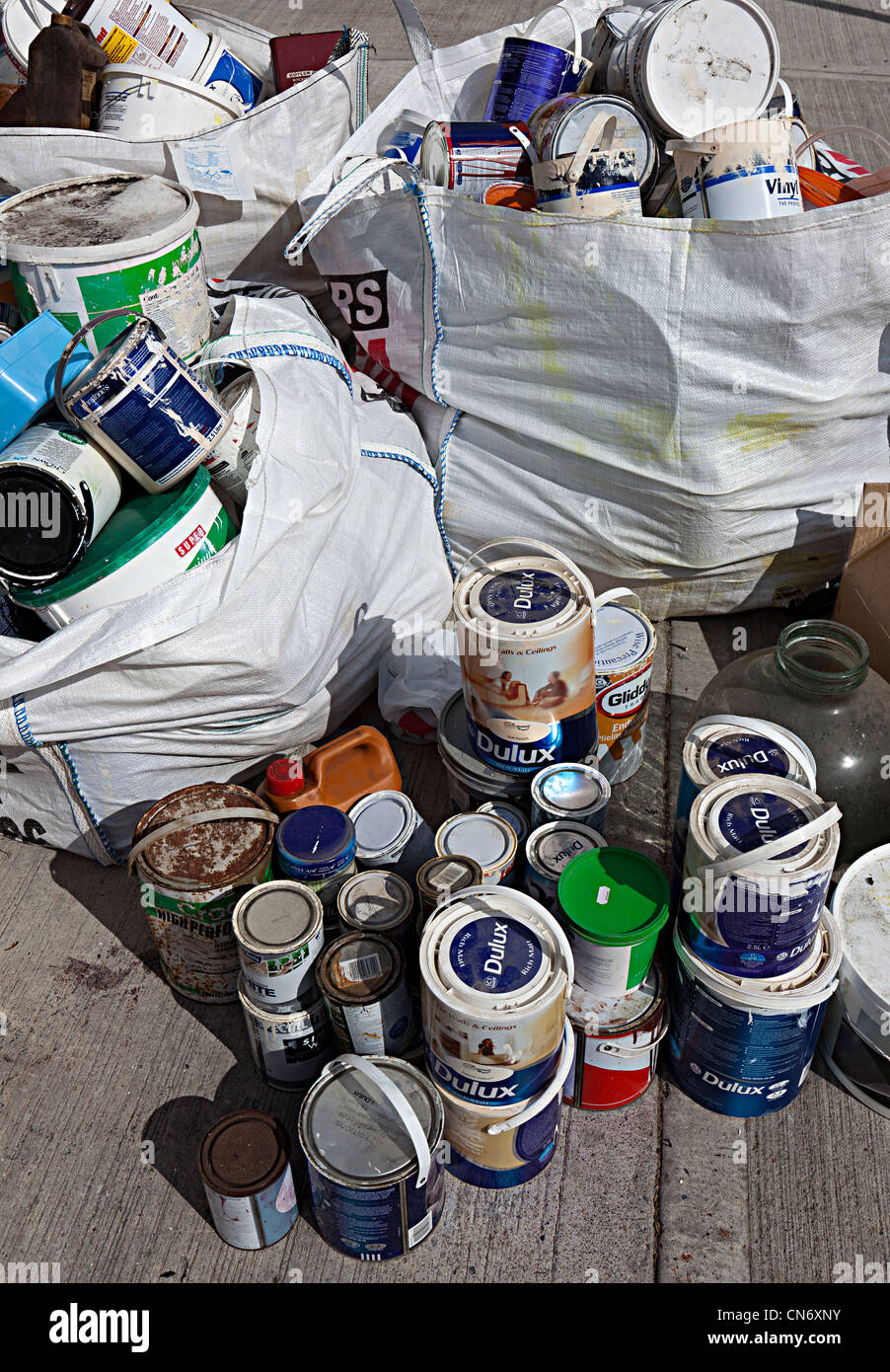 Paint cans thrown away Wales, UK Stock Photo