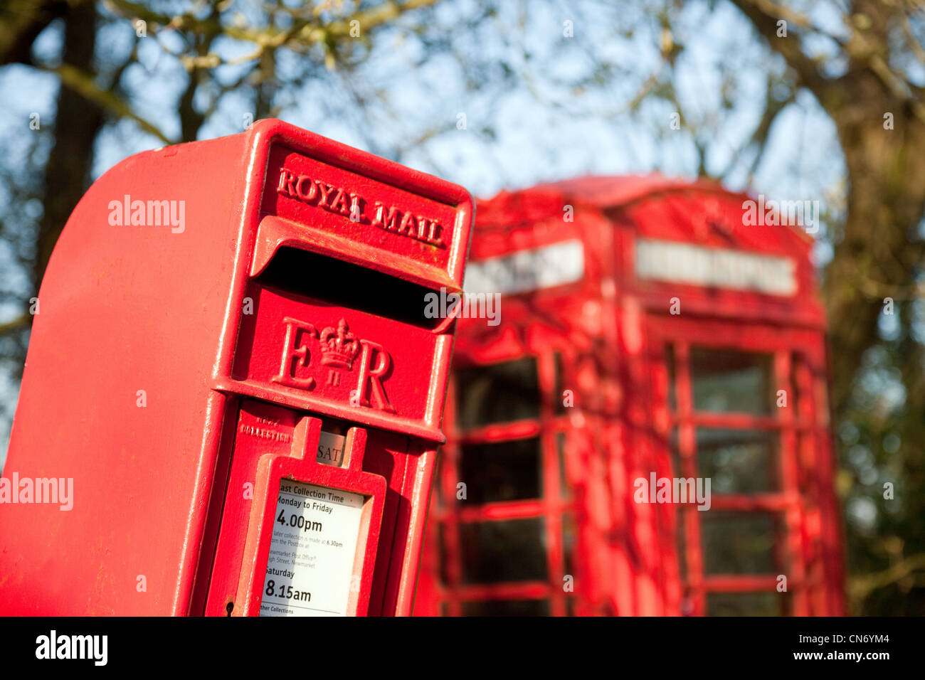 A red postbox and red telephone box, Dullingham village Cambridgeshire East Anglia UK - Stock Image