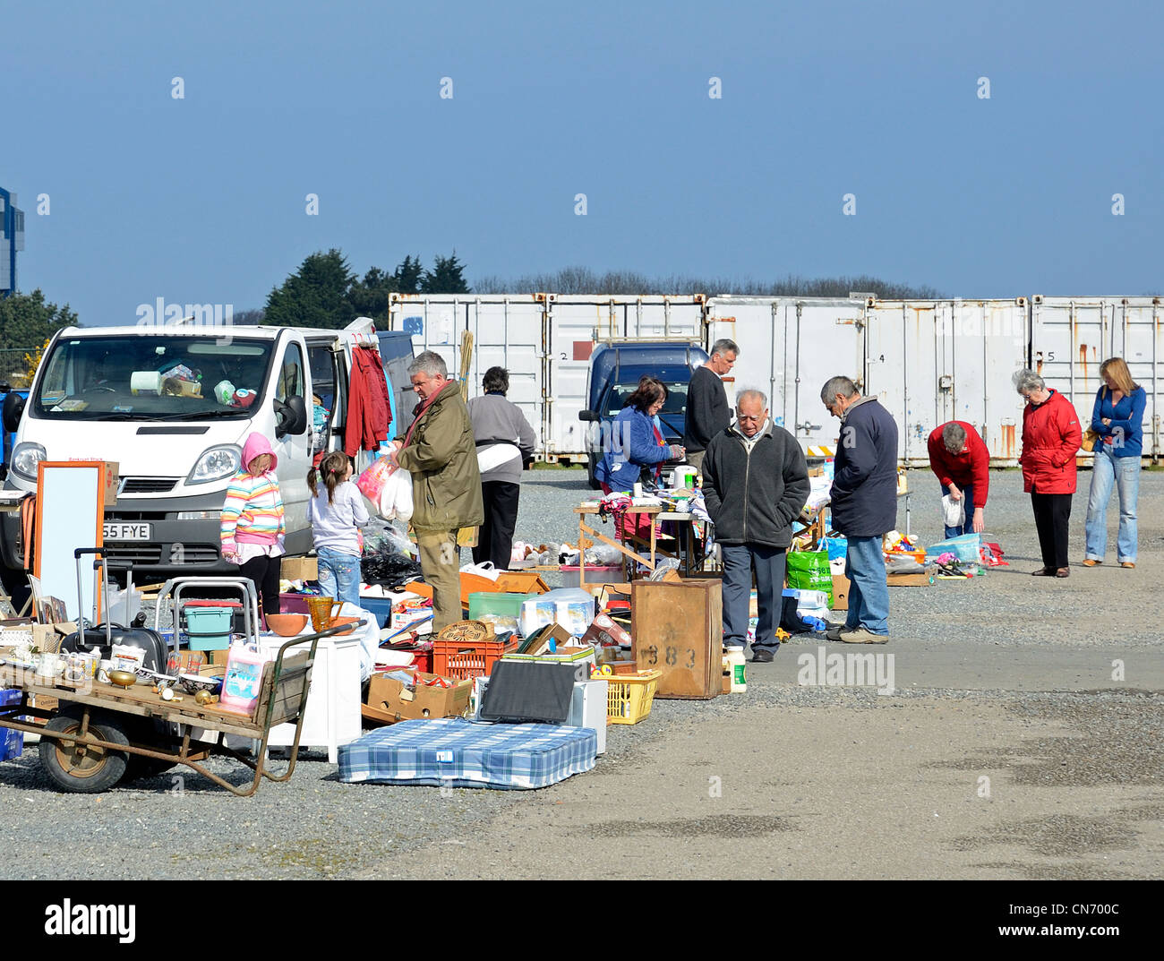 People browsing at a car boot sale near Redruth in Cornwall, UK - Stock Image