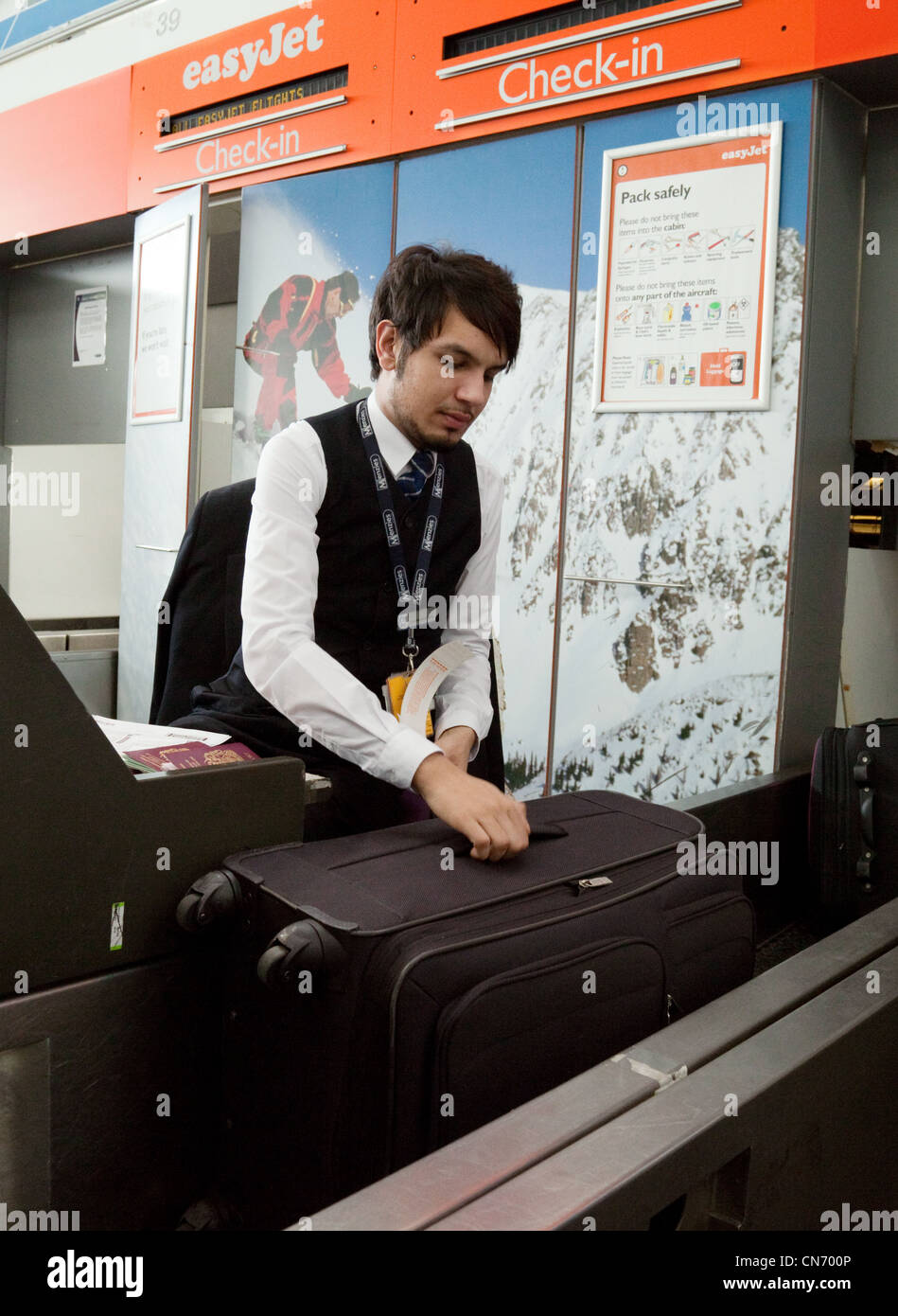 Easyjet baggage check in staff at Stansted Airport Essex UK - Stock Image