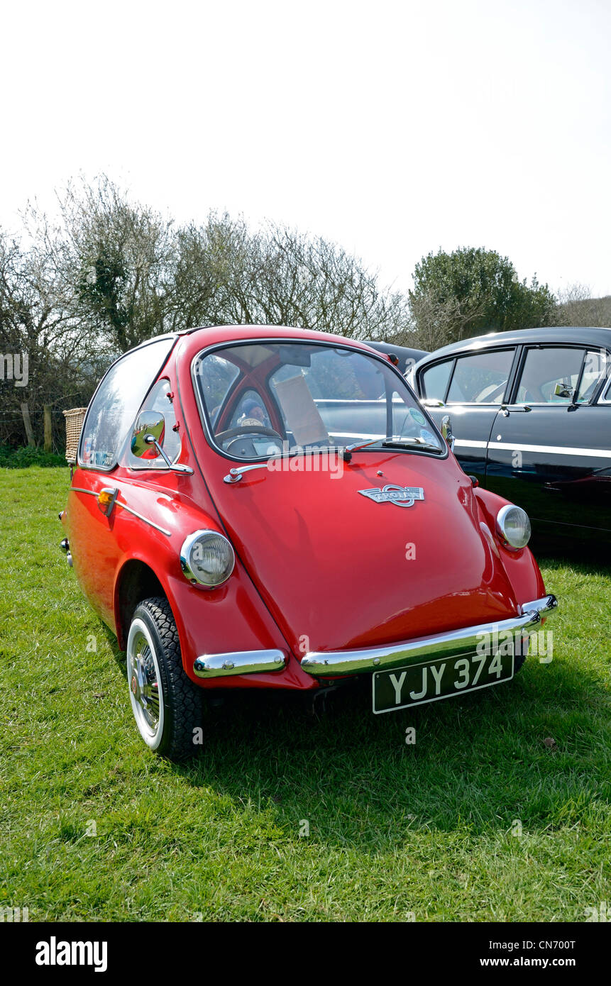 A red bubble car at a vintage motorcar rally in cornwall, uk - Stock Image
