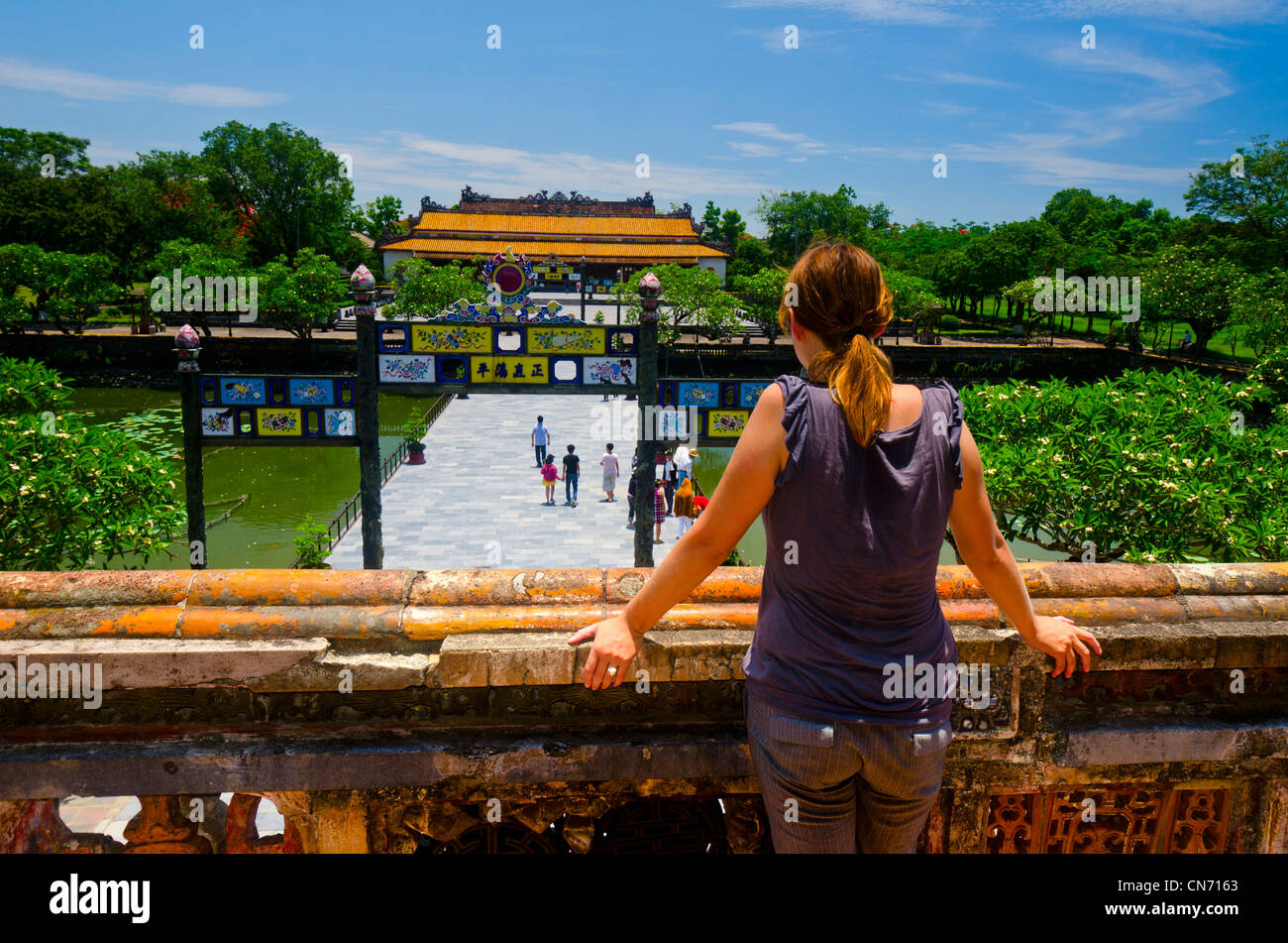 Tourist Looking into Imperial City, Hue, Vietnam - Stock Image