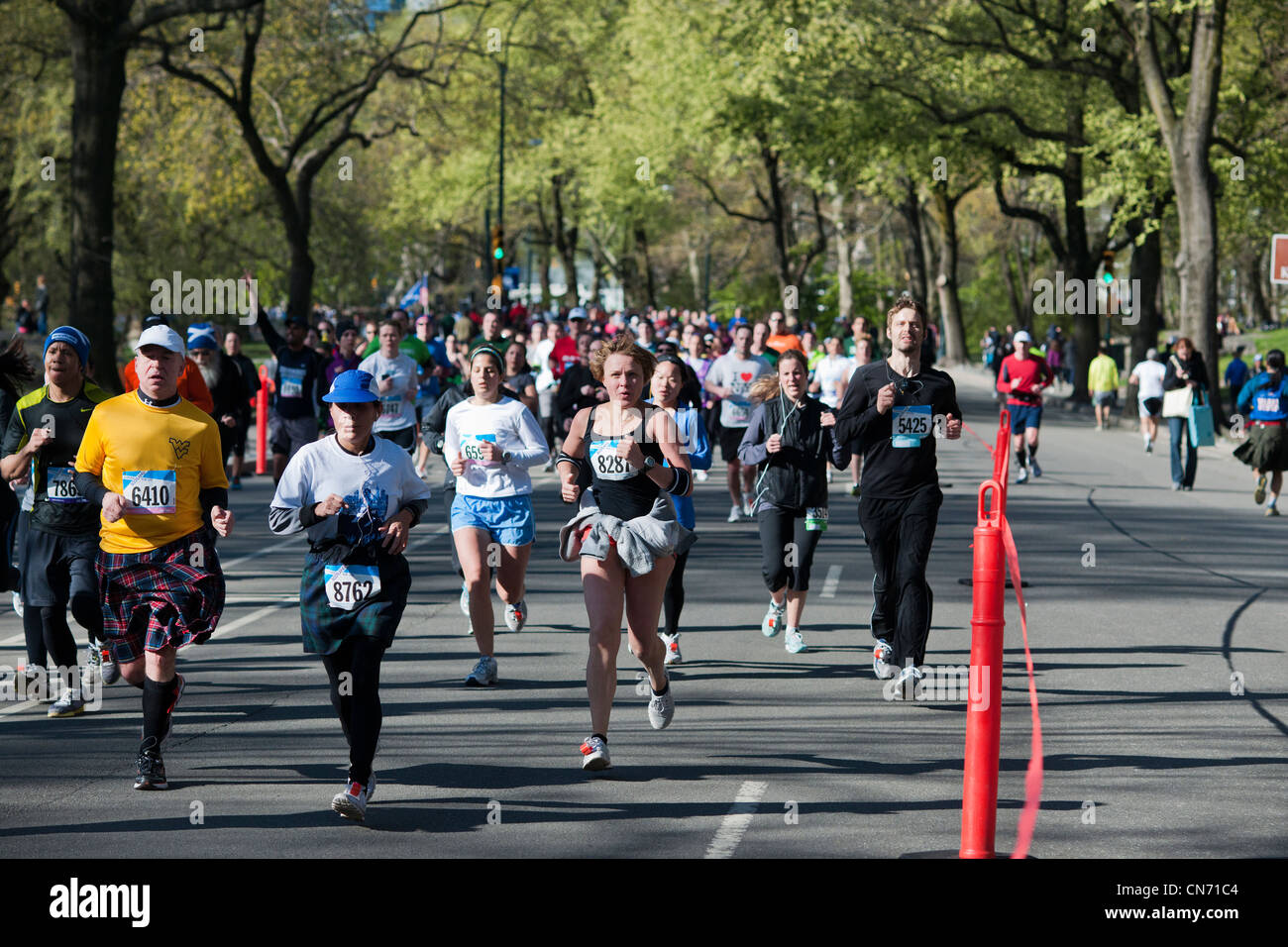 Over 10,000 runners race around Central Park in New York for the 10K Scotland Run - Stock Photo