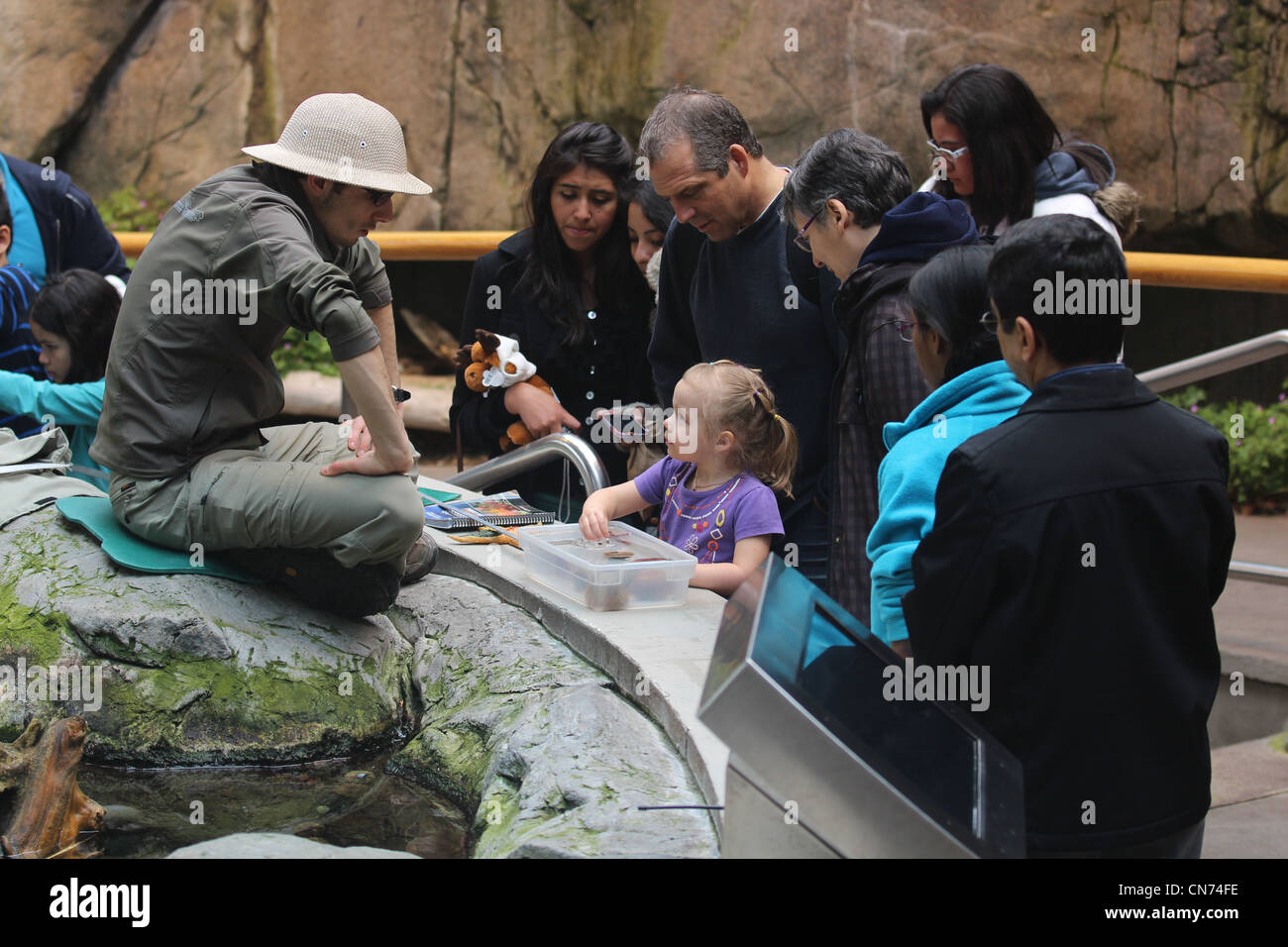 Teacher and children with aquatic animals at Biodome Montreal - Stock Image
