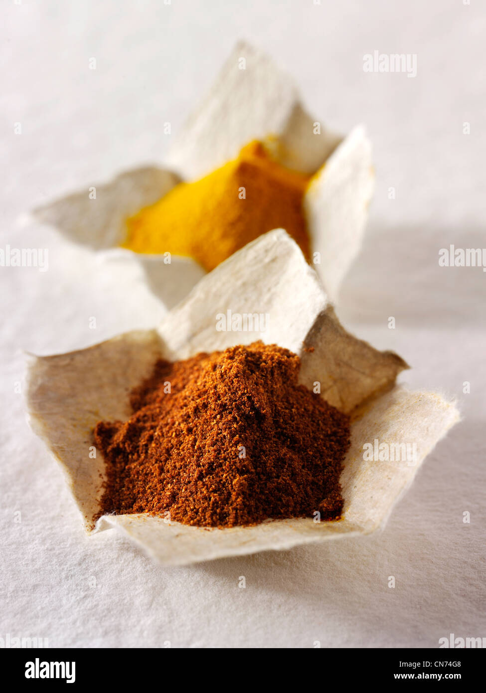 Ground chilli powder spice & ground turmeric composed arrangement - Stock Image