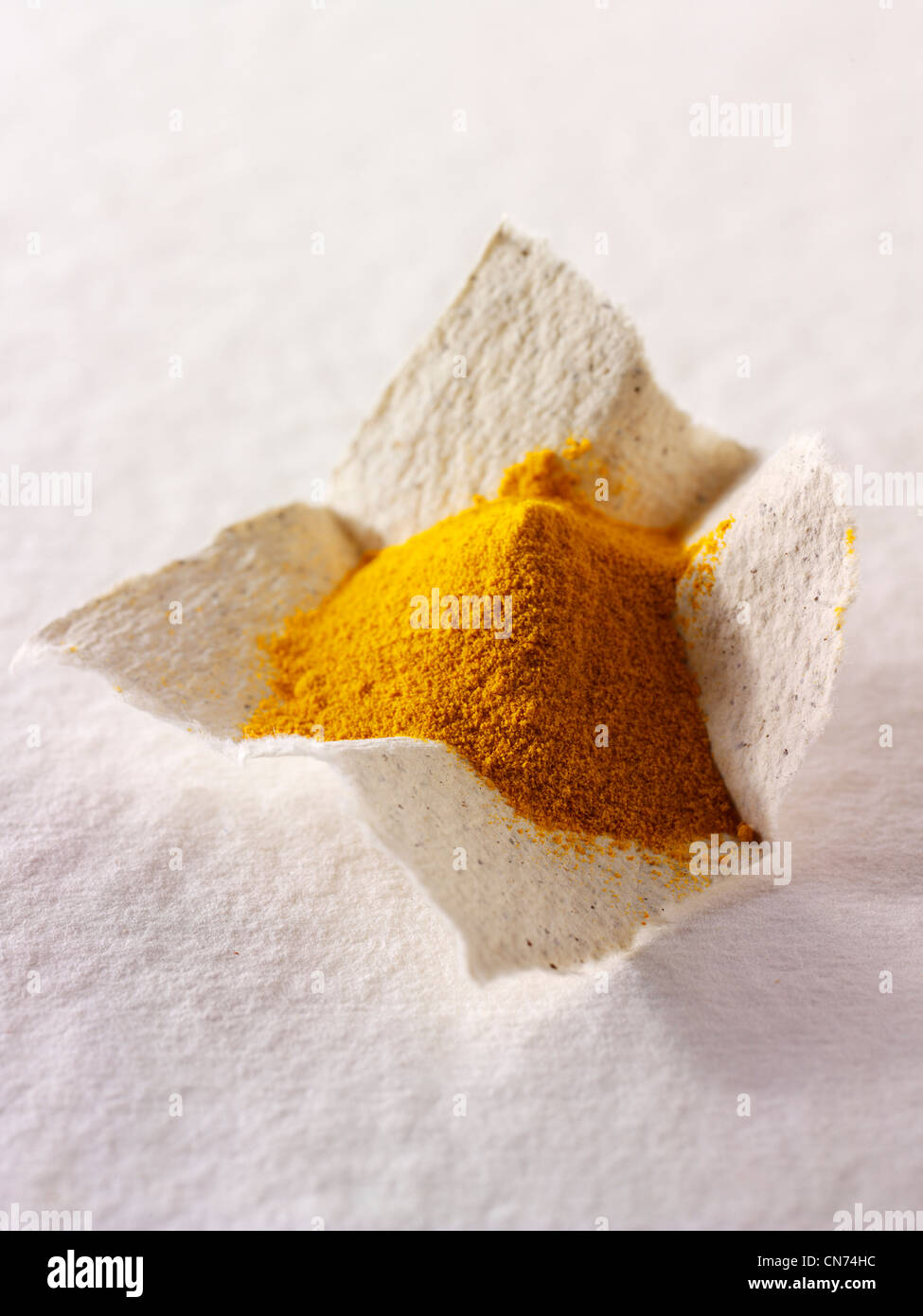Ground turmeric spice powder - Stock Image