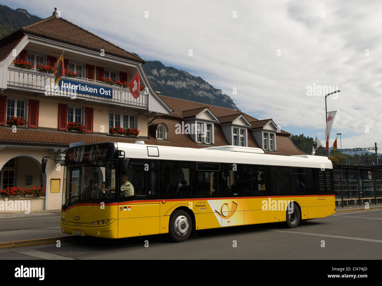 Bus outside the Ost station in Interlaken in the Canton of Bern in Switzerland - Stock Image