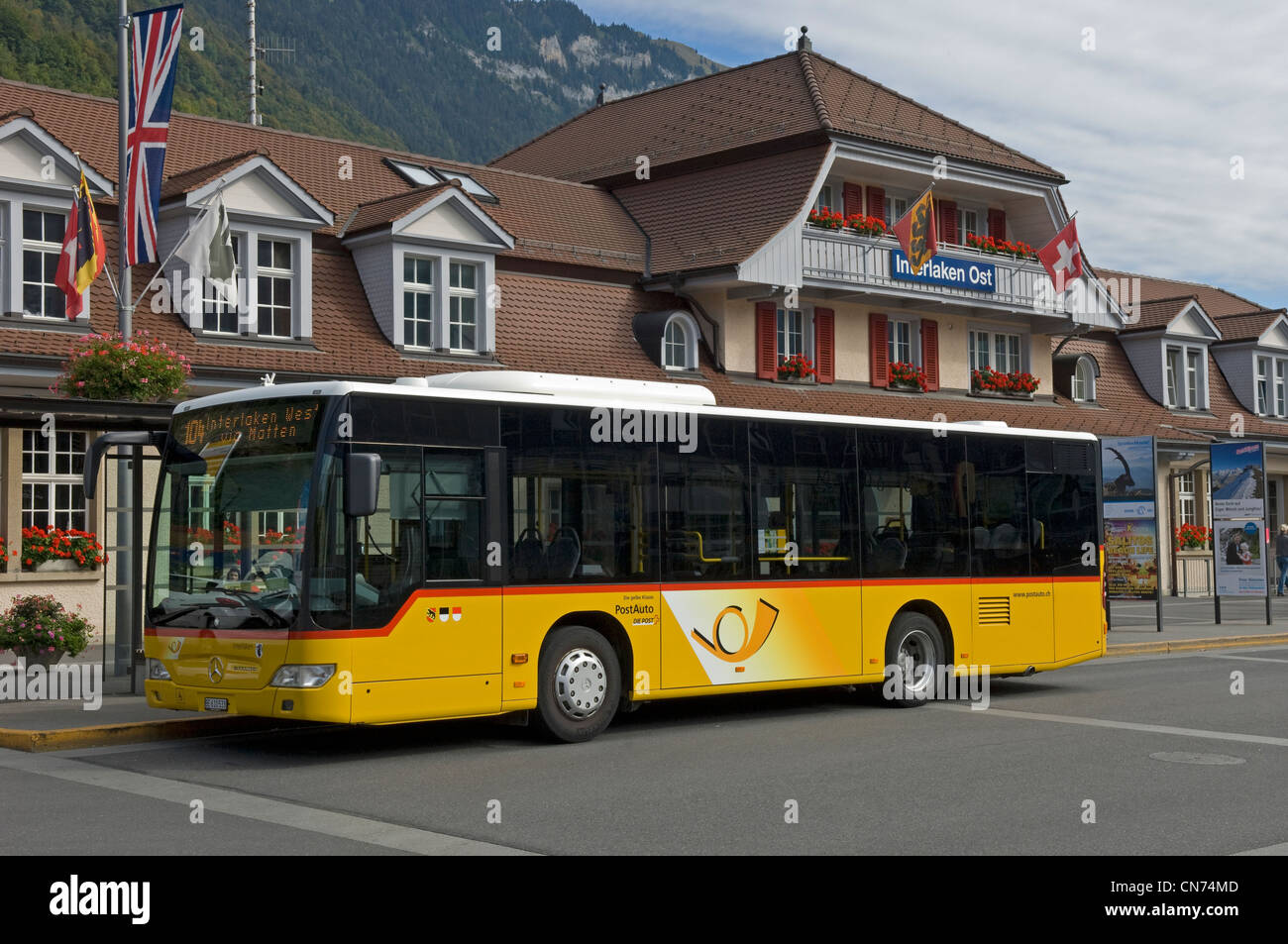 Post bus outside the Ost station in Interlaken in the Canton of Bern in Switzerland - Stock Image