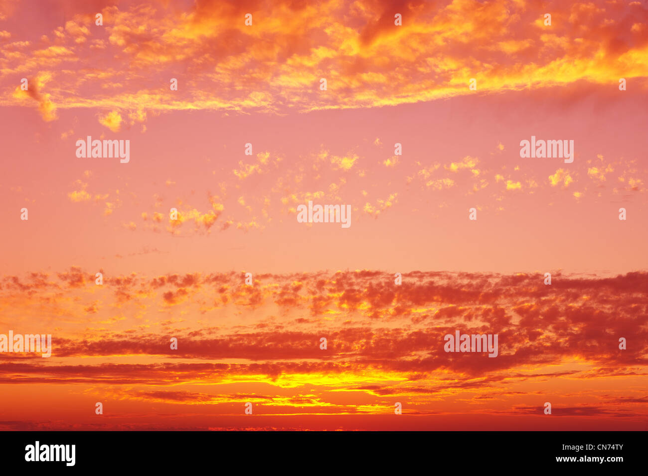 Sunset sky background in yellow and pink hues. Stock Photo