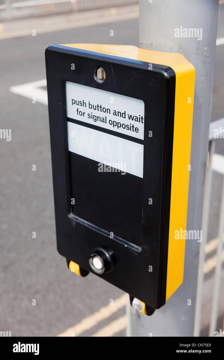 Pedestrian pelican crossing control panel button, UK - Stock Image