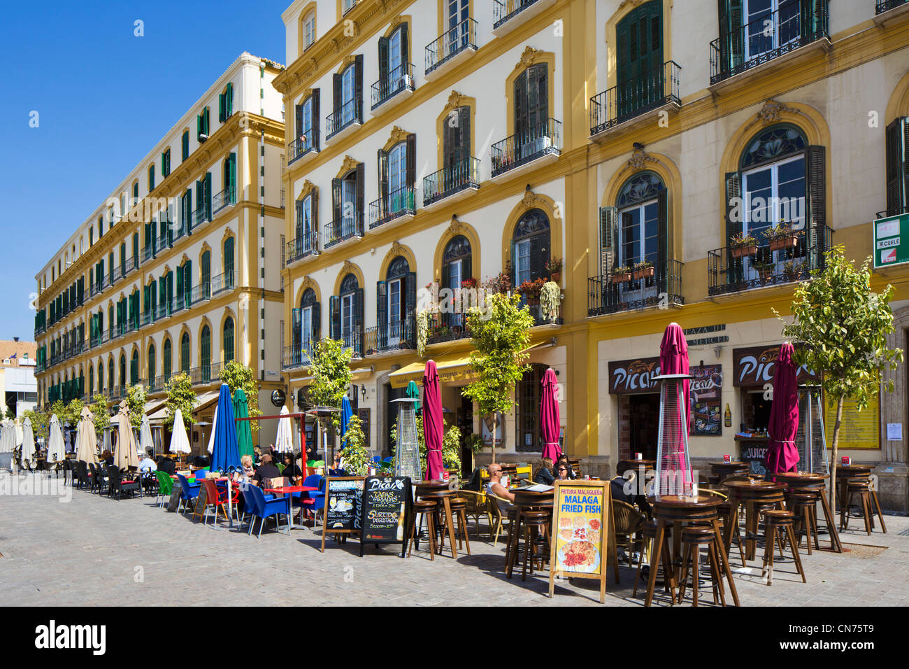 Cafes on Plaza de la Merced looking towards Picasso's birthplace (Casa Natal de Picasso), Malaga, Andalucia, - Stock Image