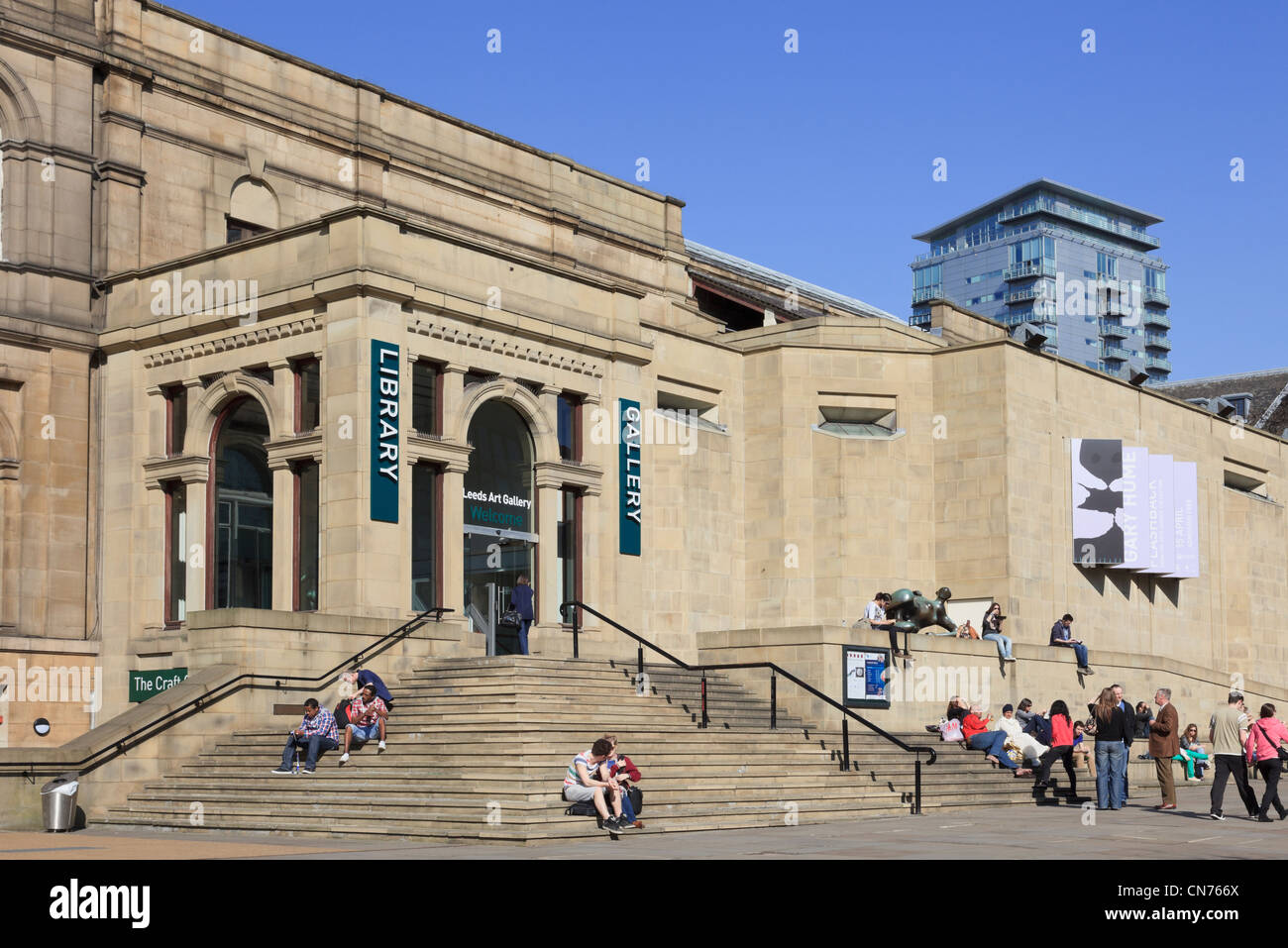 Scene with people on steps outside city public Central Library and Art Gallery in The Headrow Leeds West Yorkshire - Stock Image