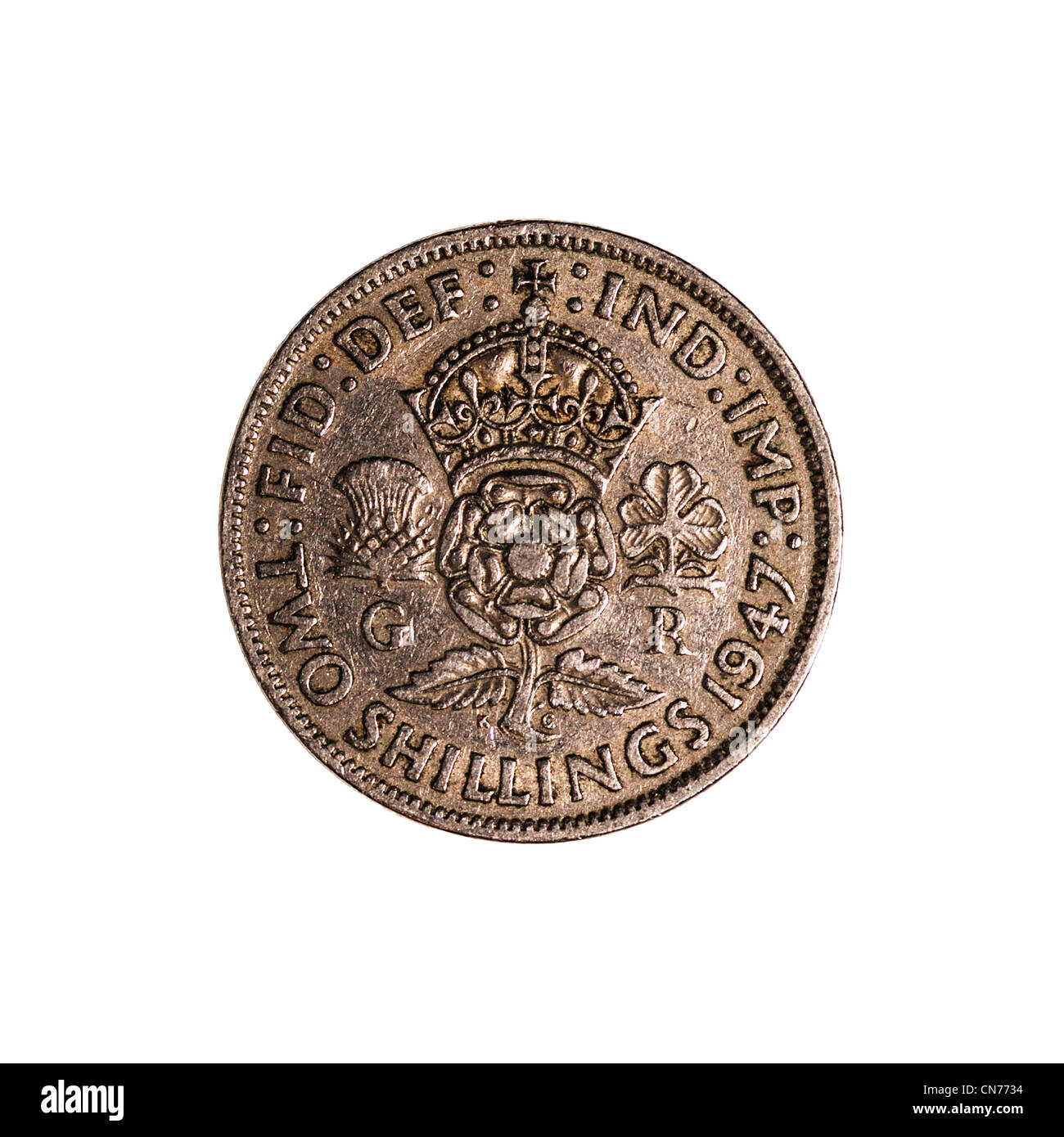 An English pre decimal two shillings coin dated 1947 on a white background - Stock Image