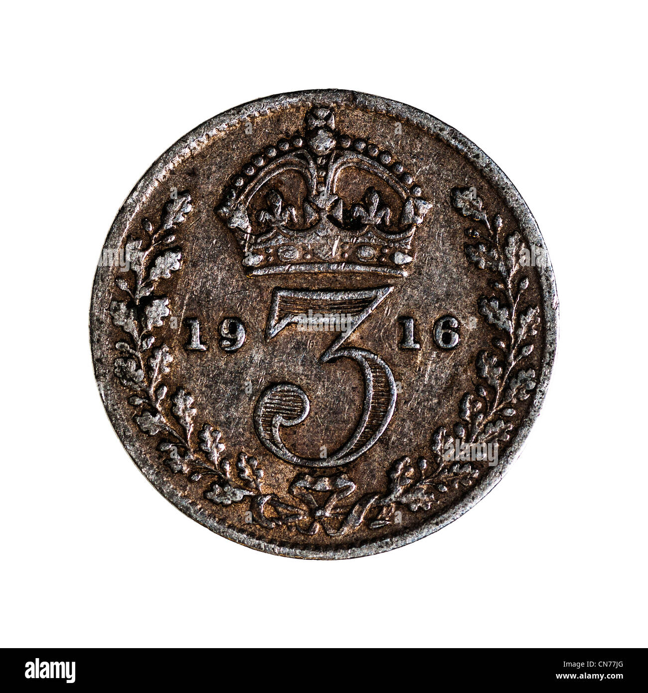 A pre decimal George V British Silver Threepence ( 1st issue ) 3 pence coin on a white background - Stock Image