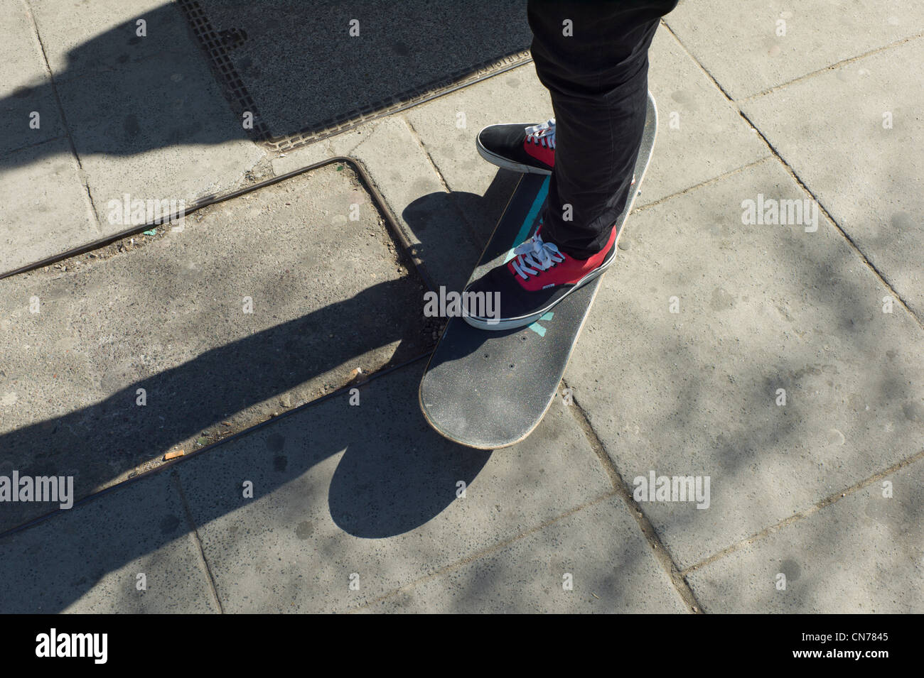 Boy standing on a skate board, Camden Town, London - Stock Image