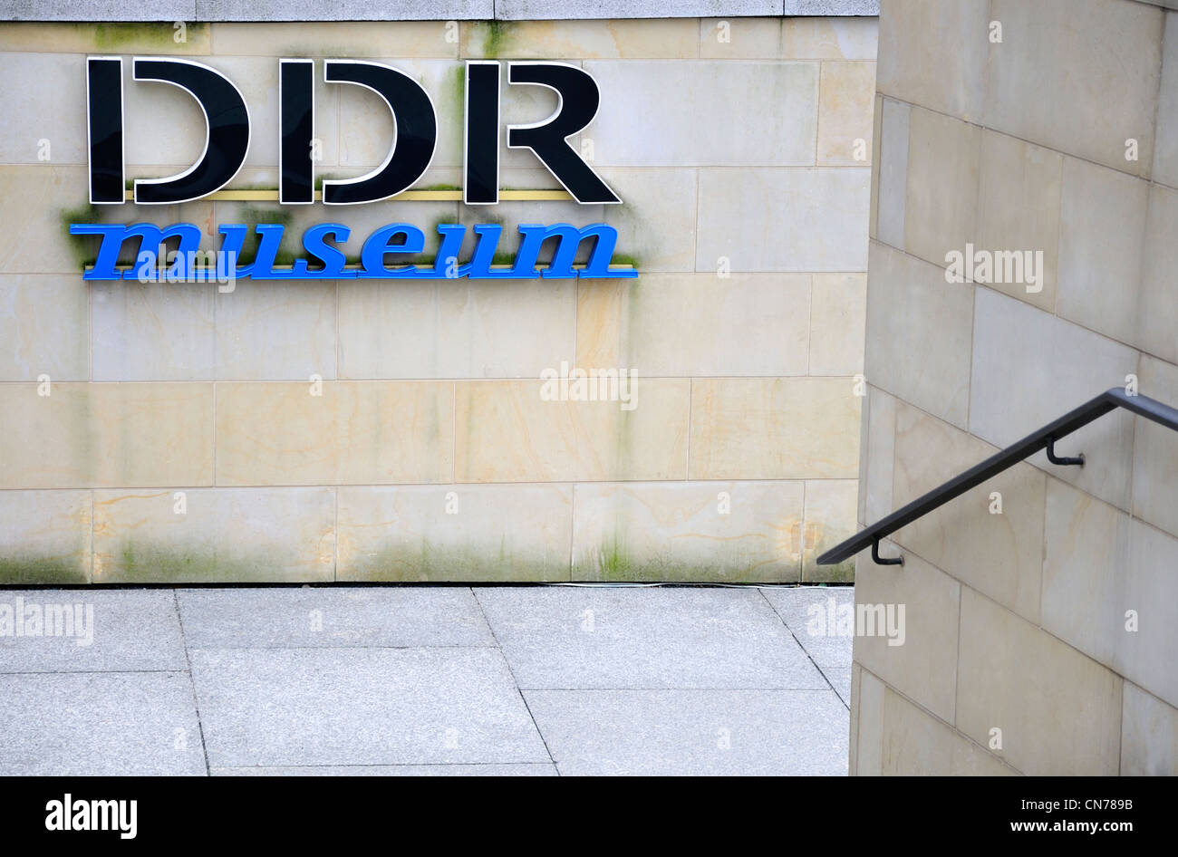Berlin, Germany. DDR Museum sign on the Spree embankment - Stock Image
