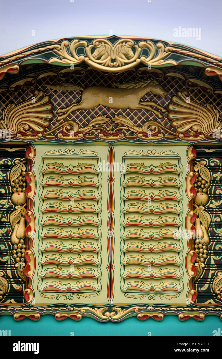 Detail of the shutters or vents on a highly decorative horse drawn caravan or Gypsy wagon at the Stow-on-the-Wold - Stock Image