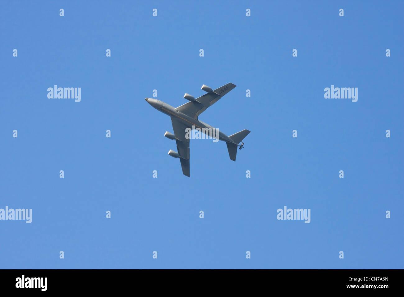 American Navy tanker airplane flying in blue sky. - Stock Image
