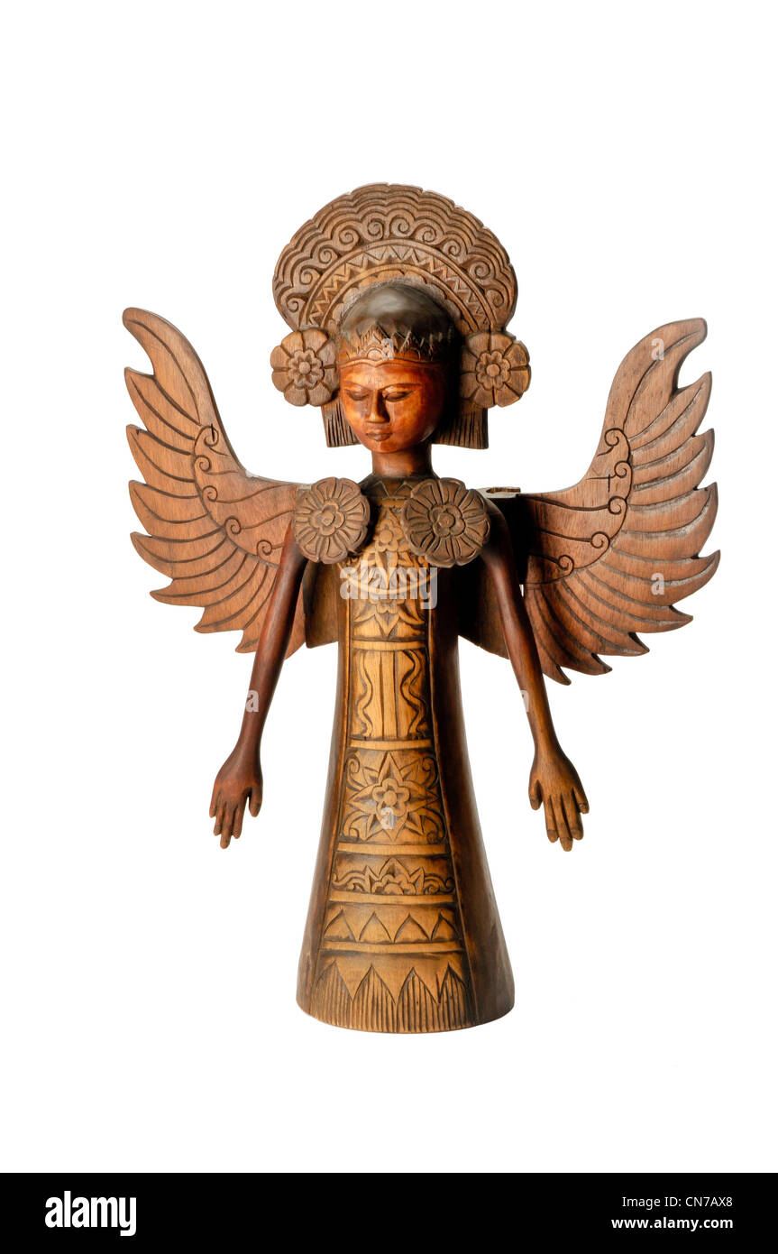 Hand carved wooden angle statue from Bali Indonesia - Stock Image