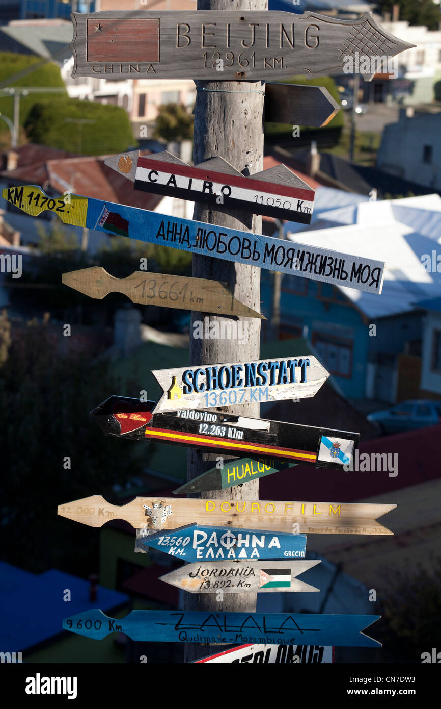 Signs indicating directions and distances of world's cities, Punta Arenas, Patagonia, Chile - Stock Image