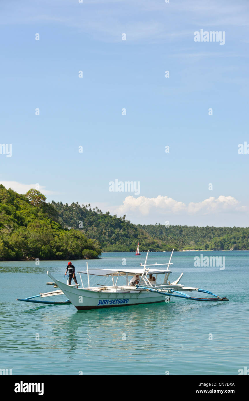 Philippine Filipino outrigger boat Puerto Galera Bay Philippines Asia - Stock Image