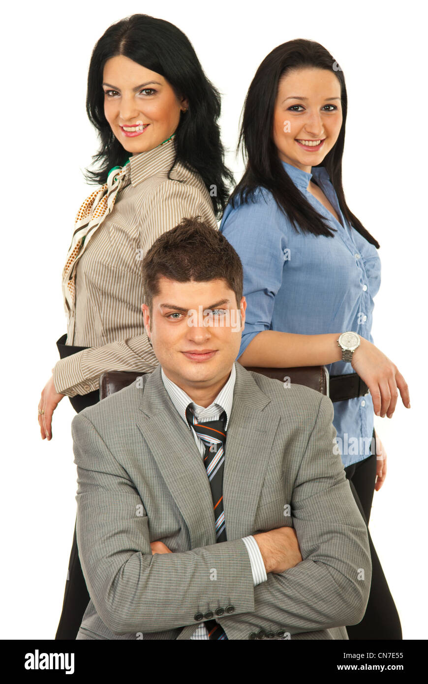 Manager man sitting on chair surrounded by two secretaries against white background - Stock Image