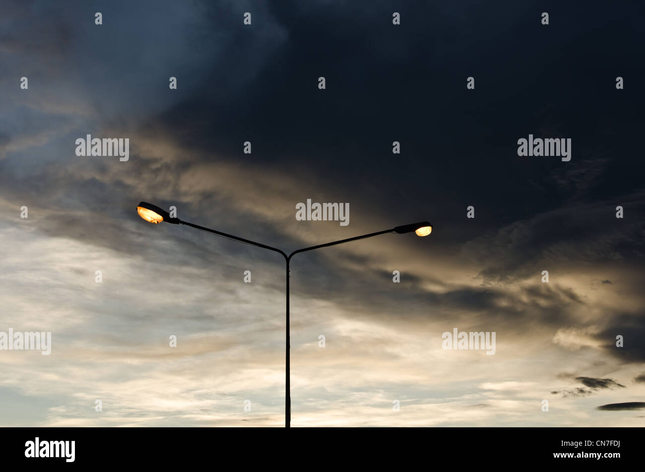 Light poles in evening on the street - Stock Image