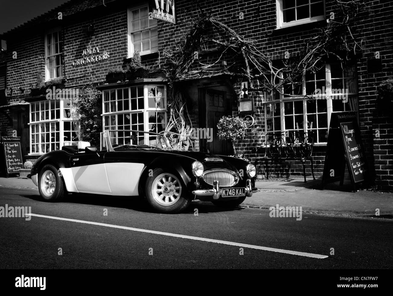 A vintage Austin Healey 3 litre convertible classic sports car parked outside the Jolly Cricketers pub Seer Green - Stock Image