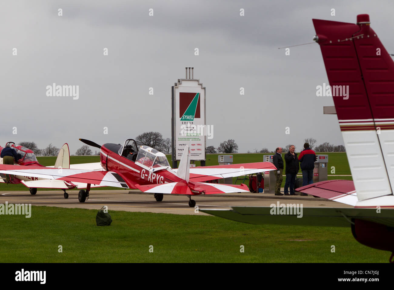 Light aircraft at fuel pumps Sywell Aerodrome Northamptonshire - Stock Image