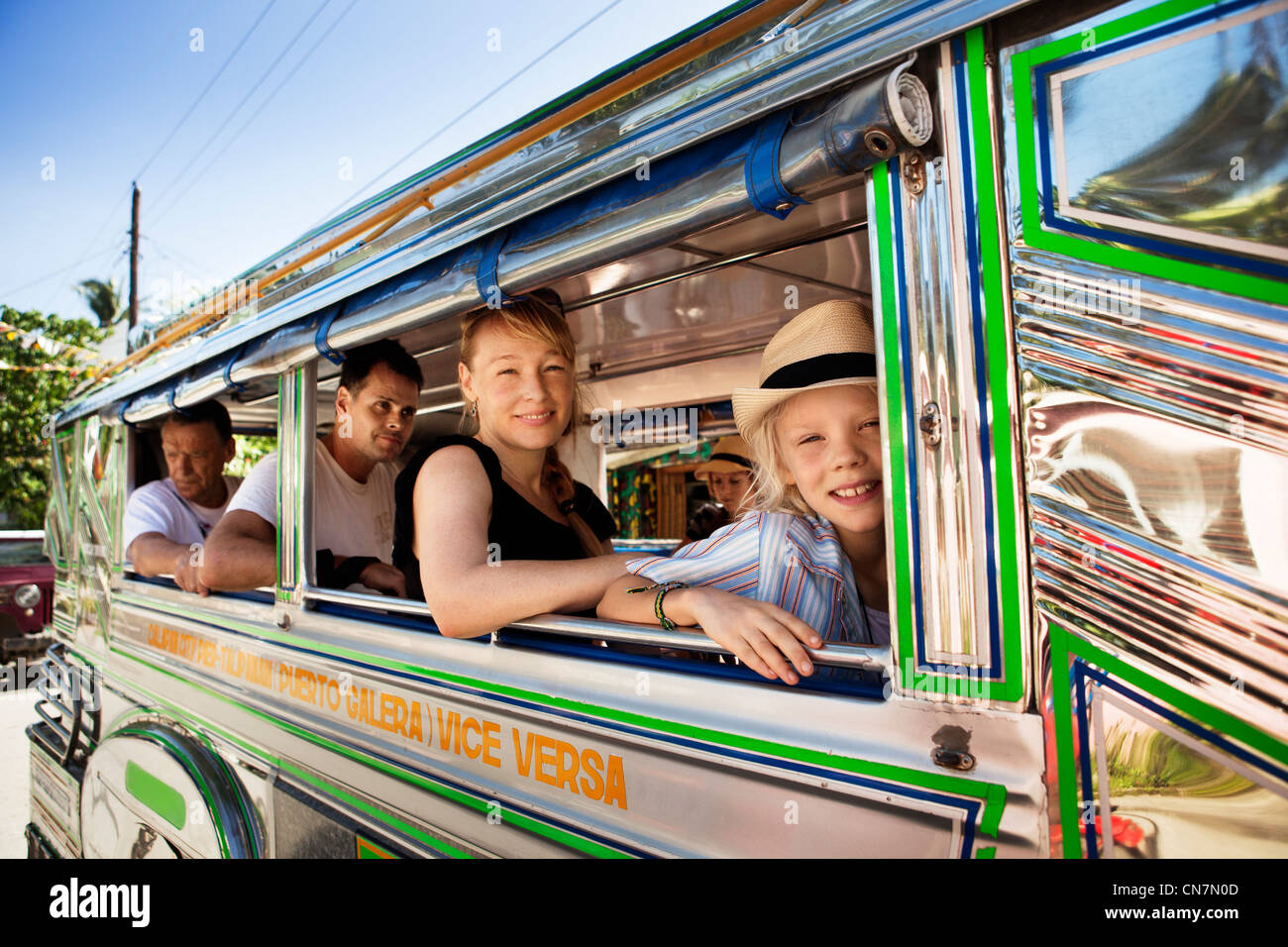 Passengers sitting by bus window - Stock Image