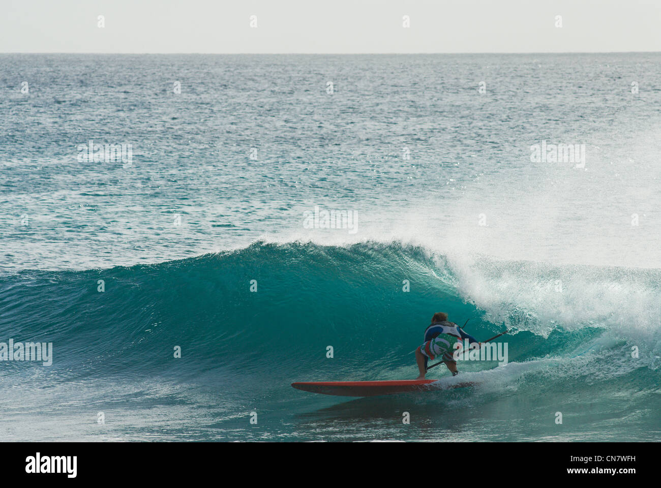 Cape Verde, Sal island, Ponta Preta, man on a longboard Stock Photo