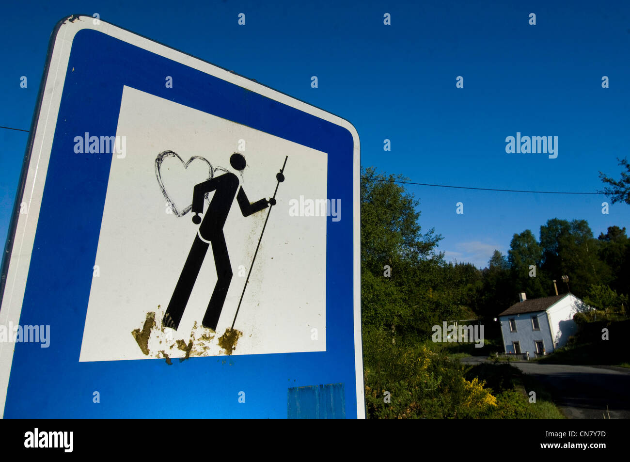Spain, Galicia, Palas de Rei, road sign warning about the passage of the Santiago pilgrims, retouched with humor - Stock Image