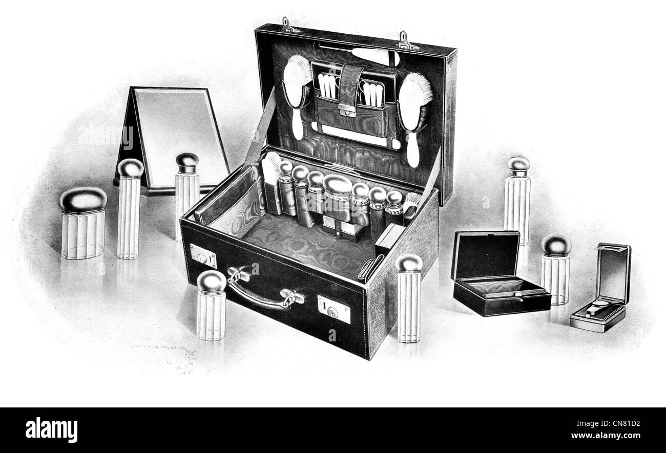 1900 grooming kit box brush perfume aftershave powder cream glass bottle suitcase mirror barber hair dresser - Stock Image