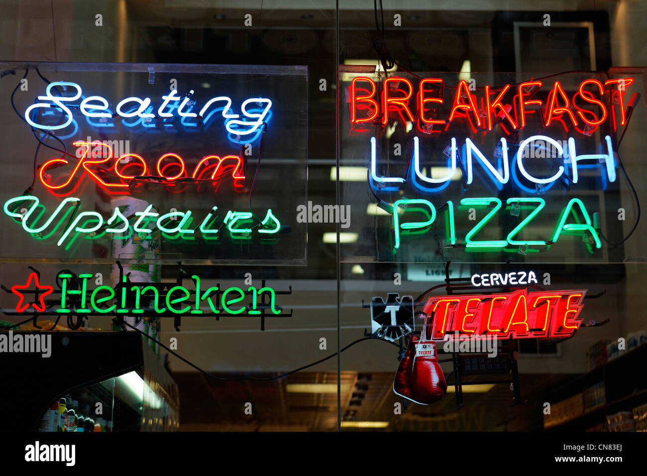 United States, New York City, Manhattan, Midtown, neon behind a window of a restaurant - Stock Image