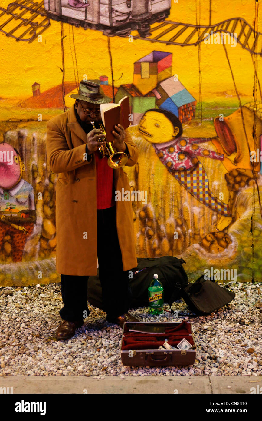 United States, New York City, Manhattan, street musician with trumpet and Bible - Stock Image