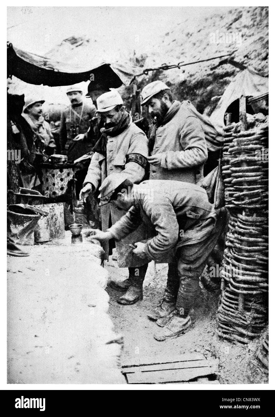 Warming wine front line trench French World War 1  First published 1917 - Stock Image