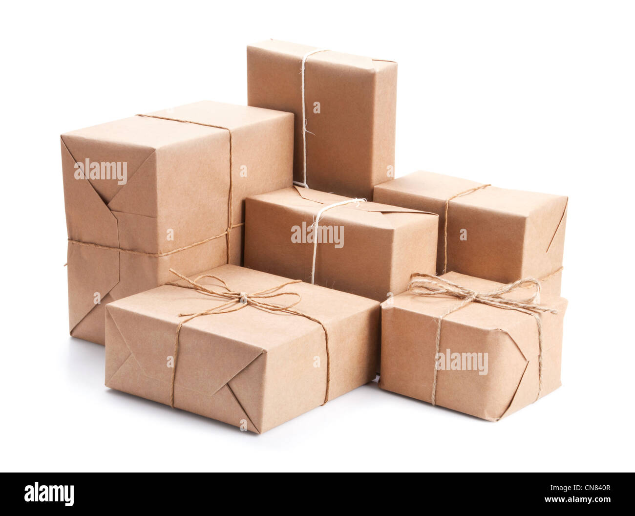 Group of parcel wrapped with brown packing paper isolated on white Stock Photo
