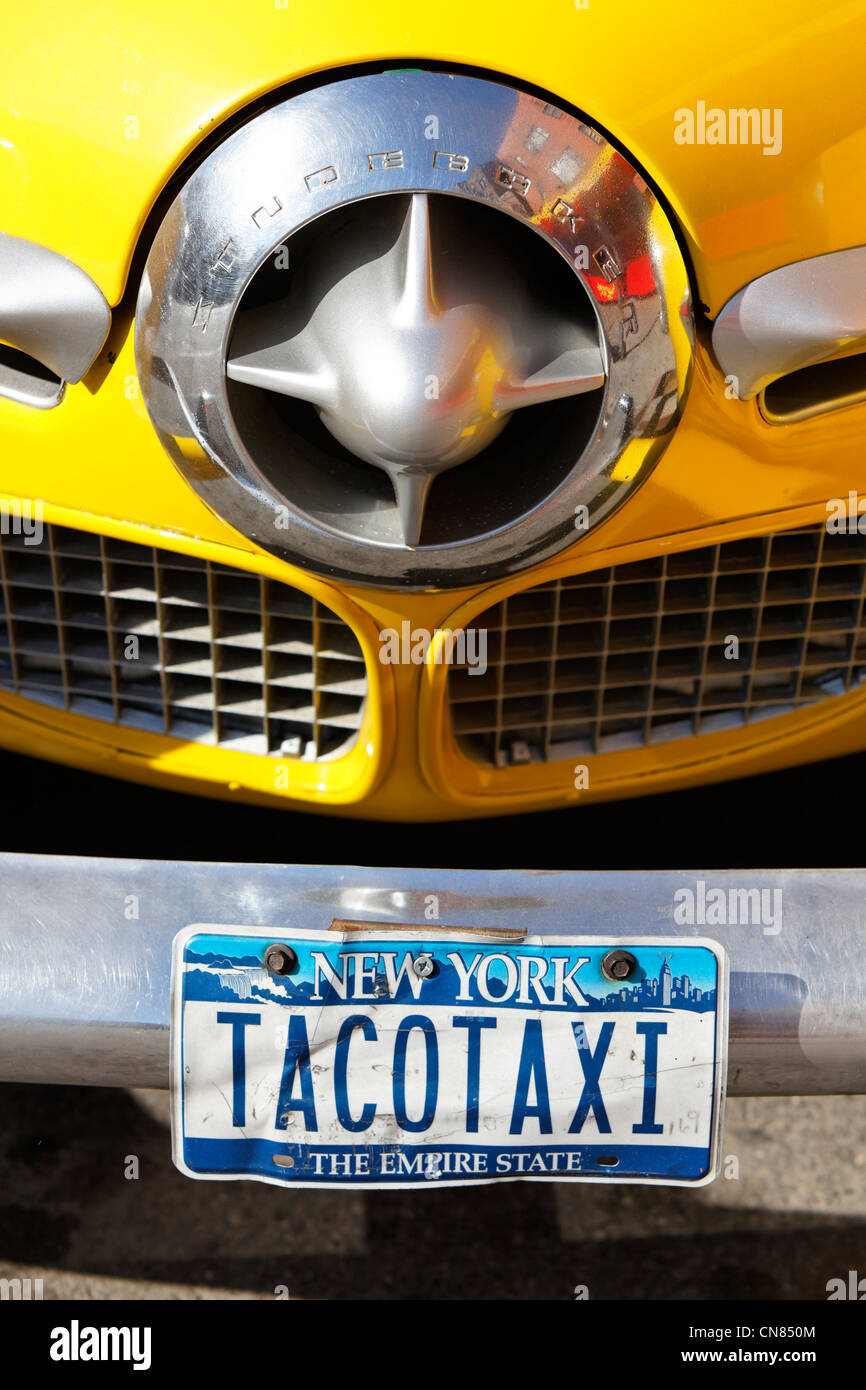 United States, New York City, Manhattan, Radiator grill of old car Studebaker, advertising for the mexican restaurant - Stock Image