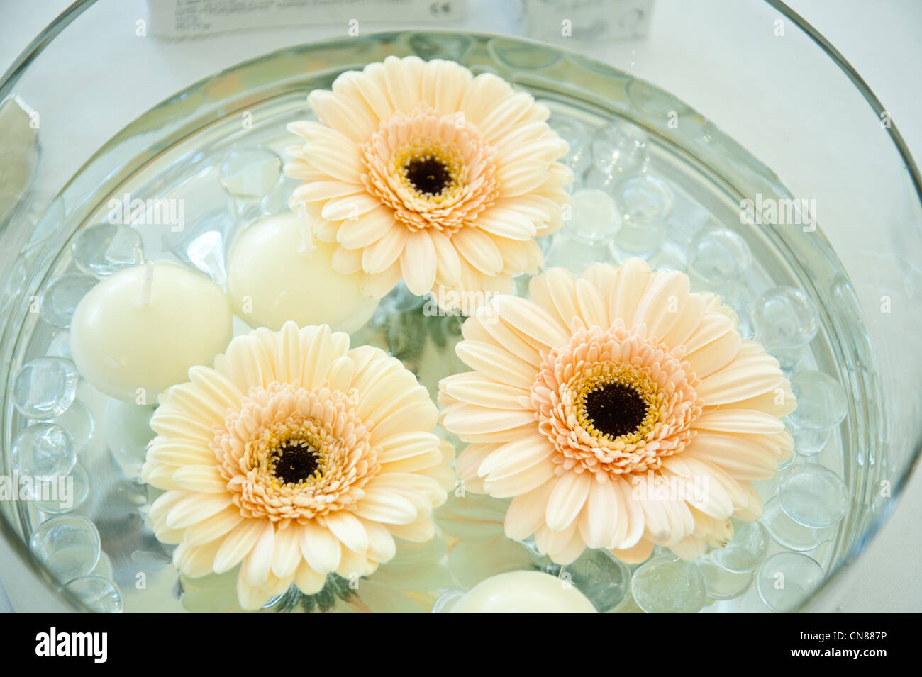A Wedding Table Decoration Floating Flowers And Candles Stock Photo