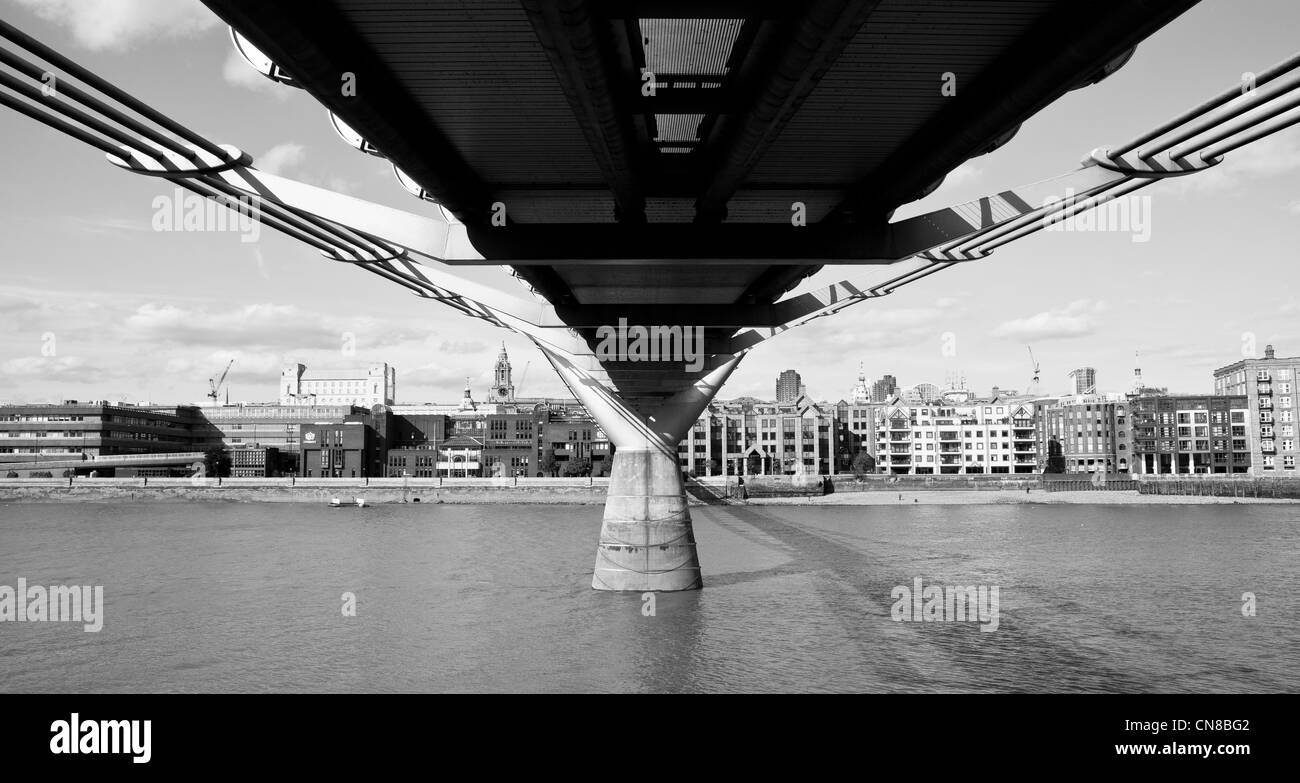 View from under Millennium Bridge on River Thames - Stock Image