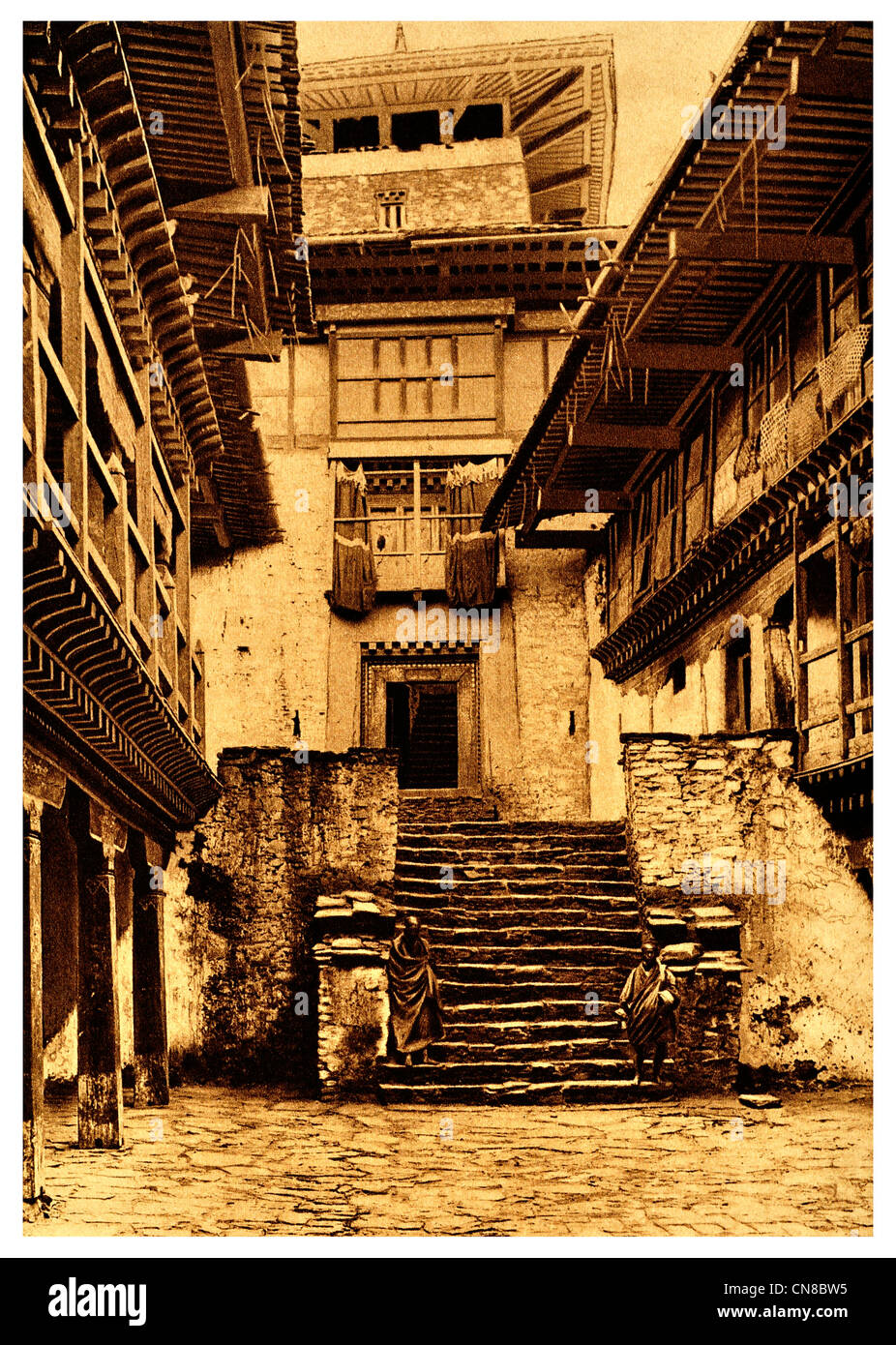 First published 1914 Bhutan courtyard temple courtyard dzong fortress - Stock Image