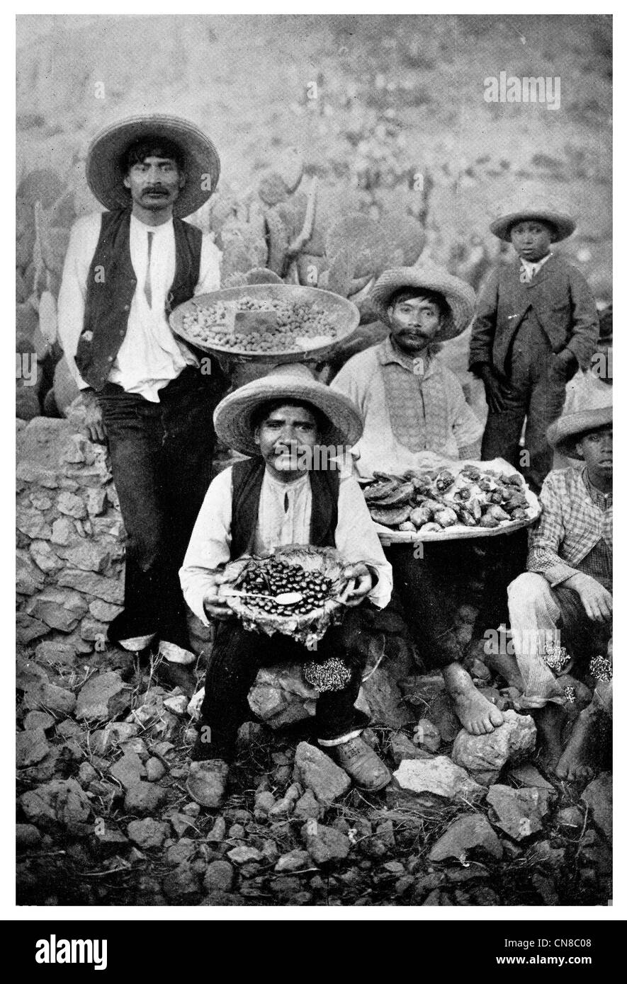 First published 1914 Peanut Sweetmeat Vender mexico mexican seller salesmenmen native basket - Stock Image