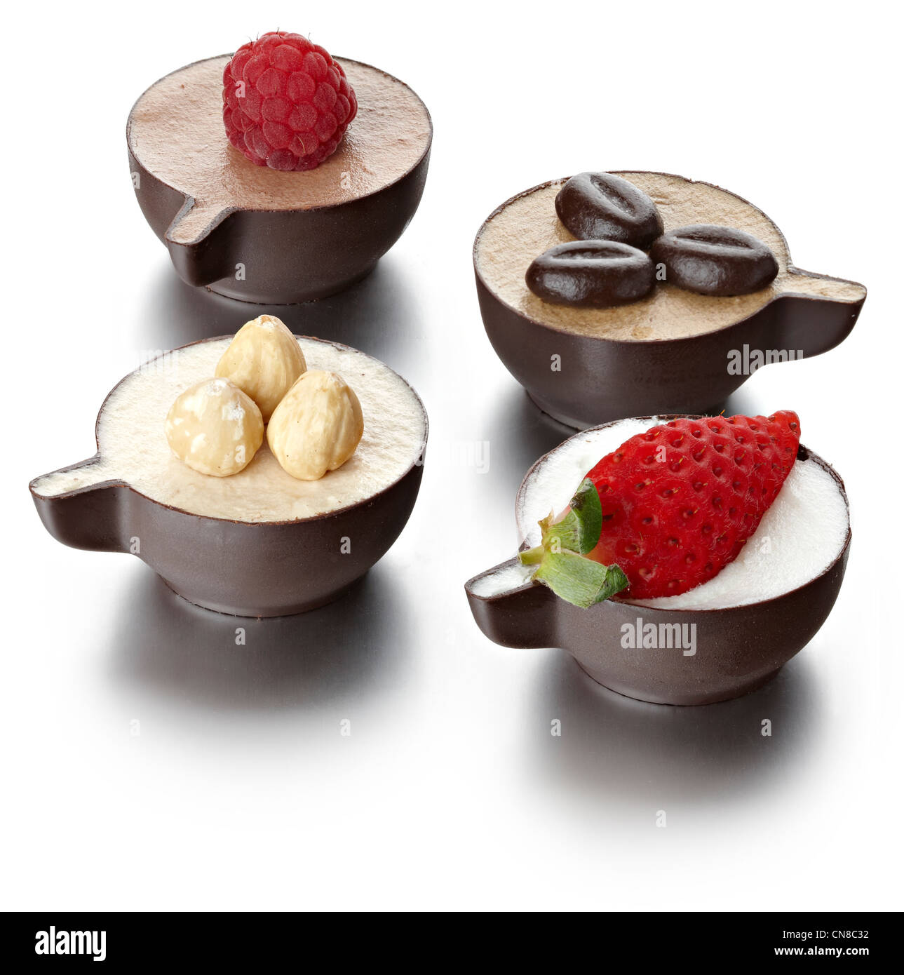 mixed group 4 chocolate cup desserts - Stock Image