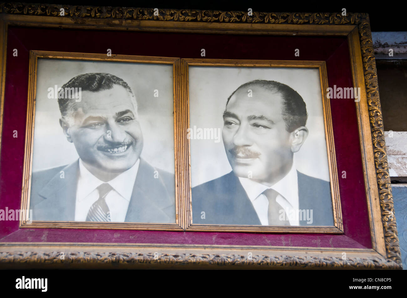 Two ex-presidents of Egypt : Gamal Abdel Nasser & Anwar Sadate in a frame in front of shop Heliopolis Cairo - Stock Image