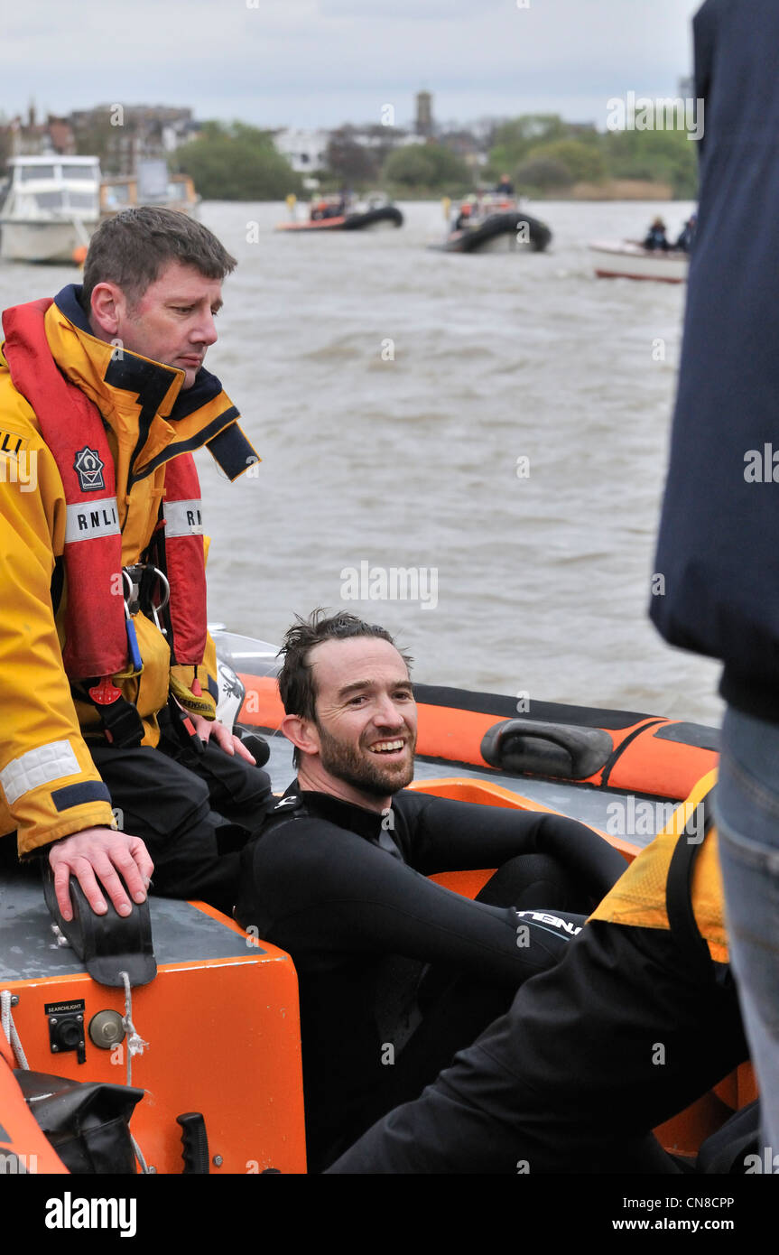 Protester against elitism Trenton Oldfield in RNLI rib looking smug after stopping the 158 th Oxford verses Cambridge - Stock Image
