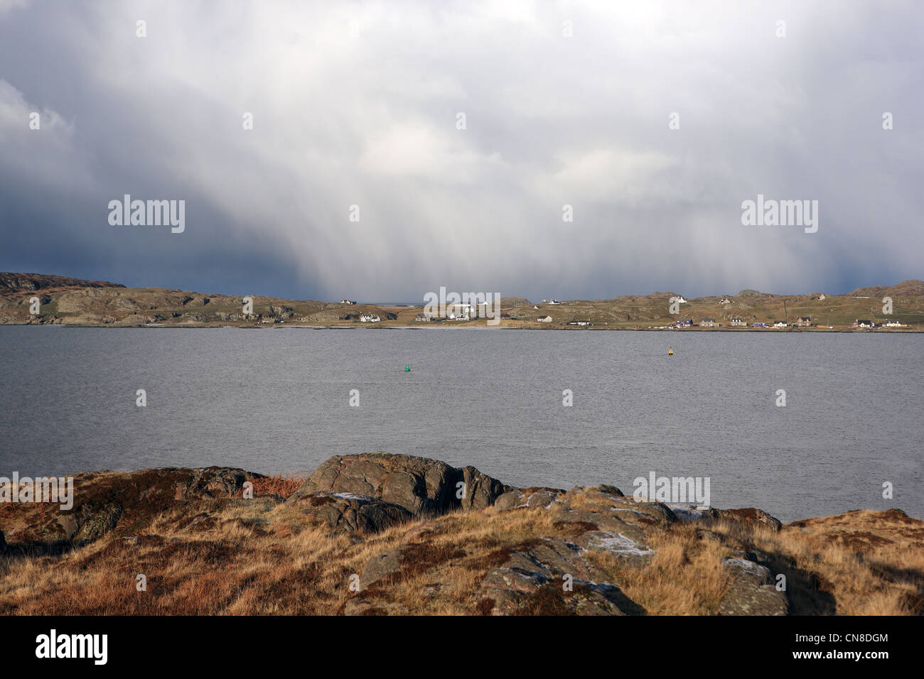 Weather system - heavy rain showers over the Isle of Iona in the Inner Hebrides of Scotland - Stock Image
